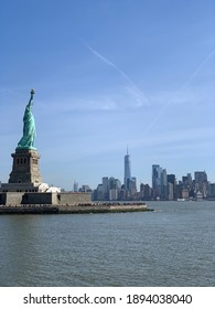A view of Statue of Liberty and New York City from Ellis island. City background. Clear skies.