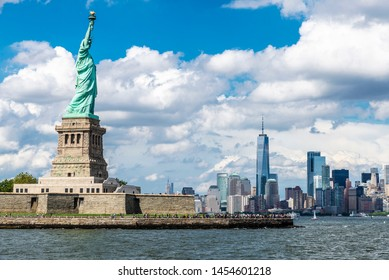 View of the Statue of Liberty and the skyline of modern skyscrapers of Manhattan in New York City, USA