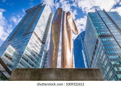 View of statue and urban office buildings West End of Downtown, Vancouver, British Columbia, Canada, North America 12 September 2017