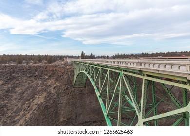 View of steel arch bridge as seen from Peter Skene Ogden Park near Terrebonne, Oregon.