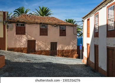 View to a steep street with colorful houses in San Andres village in the east of La Palma, Spain.