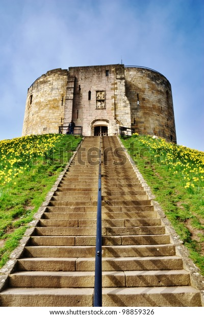 View up the steps and motte to the medieval keep of York Castle known as Cliffords Tower, York, England