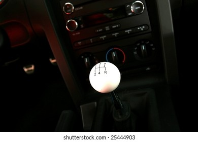 View of a stick shift in front of console