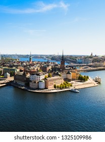 View of Stockholm skyline on Gamla Stan from above at the top of Stockholm Stadshus / town hall during a clear summer day (Stockholm, Sweden, Europe)