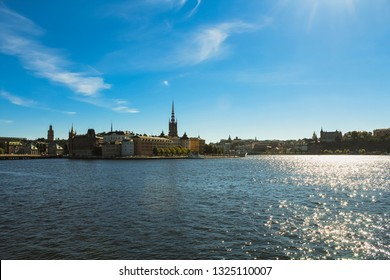 View of Stockholm skyline on Gamla Stan during a perfect blue summer day with clear sky as seen from Stockholm Stadshus (Stockholm, Sweden, Europe)
