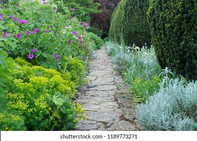 View of a Stone Paved Path through a Beautiful English Style Landscape Garden