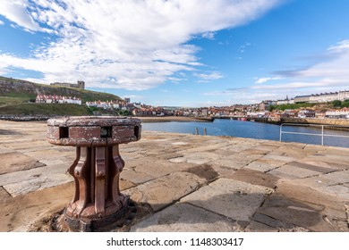 View from stone pier towards Tate Hill and St Mary's Church, Whitby, North Yorkshire, England.