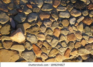 View of the stone platform at the pier on the seashore. Wet stones from the waves of the surf