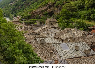 view of stone roofs called the losa roofs of an ancient valdostan village in Italy/the losa are stone slabs,  dating back to the 1400-1600 century, extracted  from the mountain and laid to the roofs