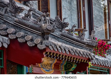 View of Stone Rooftop Decorations (Dragon, Qilin, Mythical Beasts) on Doorway of Historic Building (Beijing, China).