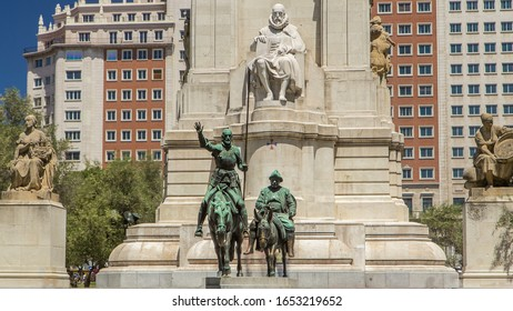 View of the stone sculpture of Miguel de Cervantes timelapse and bronze sculptures of Don Quixote and Sancho Panza on the Square of Spain (Plaza de Espana).