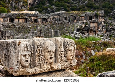 View of stone stage masks in front of an ancient amphitheater in Myra Turkey