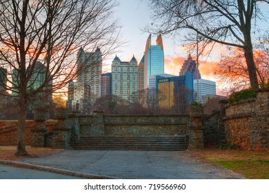 View of stone stairs in the Piedmont Park and Midtown Atlanta behind it in autumn evening, USA