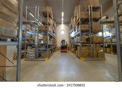 View of storage warehouse. Fork lift truck in warehouse store.  Transportation concept.  02.12.2021. Enkoping. Sweden.