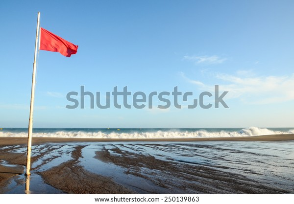 View of Storm Seascape and Red Flag on the Atlantic Ocean
