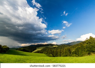 View of stormy clouds in summer over a field in Slovakia