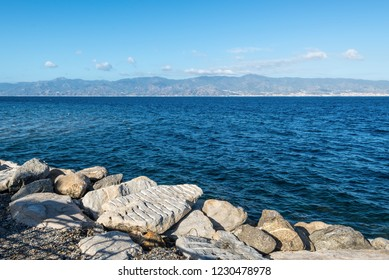 View of Strait of Messina connected Mediterranean and Tyrrhenian sea and Sicilia island background, Reggio Calabria, Southern Italy