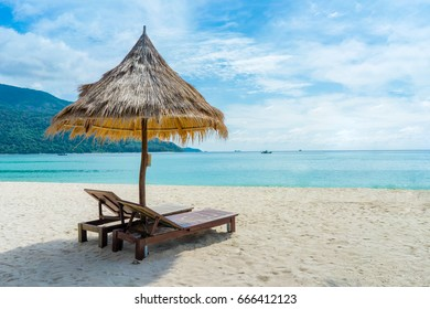 The view of Straw umbrella on the tropical beach at lipe thailand island with white sand, turquoise ocean water and blue sky.
