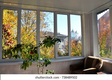 View of the street and autumn landscape from the verandas with metal-plastic windows