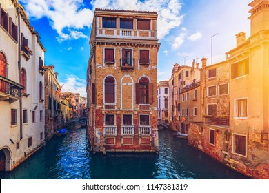 View of the street canal in Venice, Italy. Colorful facades of old Venice houses. Venice is a popular tourist destination of Europe. Venice, Italy.