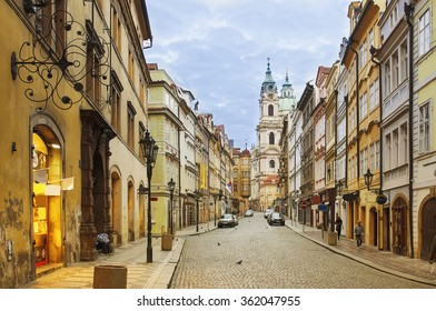 View to the street in the old center of Prague - the capital and largest city of the Czech Republic - travel background
