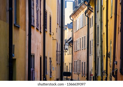 View of a street in the old town of Stockholm city in Sweden, with typical old building facades with waterspouts, zoomed in in to the perspective creating a flat perspective illusion