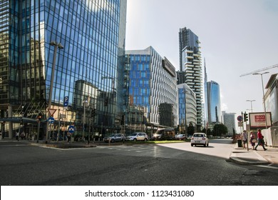 A view from the street on an urban landscape in financial district of Milan, with a beautiful bright sky. Italy-Milan 22 June 2018