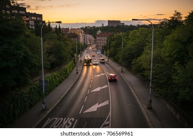 View of a street at Žižkov (part of Prague in czech republic) with skola sign on the ground (meaning school in english) in sunset with the zizkov monument in the distance - Shutterstock ID 706569961