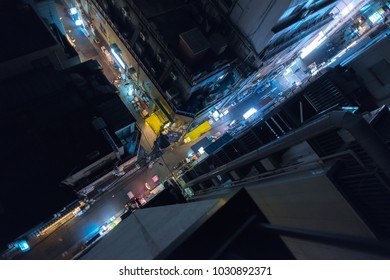 View of the streets by night from the rooftop in Tokyo, Japan.