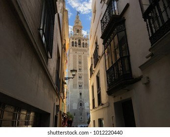 "View from the streets of the neighborhood of Santa Cruz, towards the famous ""Giralda"" of Seville"