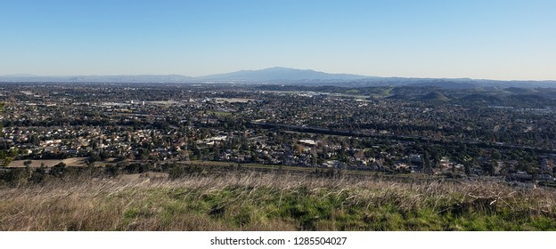 View of suburbs and mountains from a hill side, California