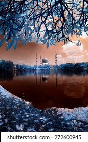 View Sultan Salahuddin Abdul Aziz Shah Mosque by lakeside in Infrared. Image has grain or blurry or noise and soft focus when view at full resolution.  (Shallow DOF, slight motion blur)