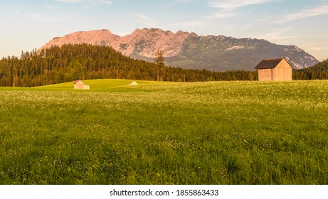 View from a summer field  to sunset over mountain Grimming in Styria, Austria