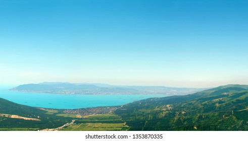 View from the summer green mountains to the Black Sea coast, bay, panoramic view. Rossia, Tsemesskaya Bay, Novorossiysk, Kabardinka