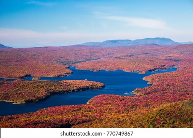 View from the Summit of Mt Snow, Vermont, near the town of Dover. Somerset reservoir and a huge hardwood forest in colorful fall foilage can be seenon the surrounding lands and waterways.