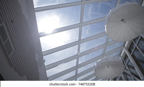 View of the sun and blue sky through the window slide motion. Skylights. View from the window. View of the sky from the window. Window on the roof. Sunlight through the roof. Light in the house