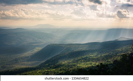 View of sun rays shine on mountain and plateau taken from Na Noi cliff, Phu Kradueng National Park, Loei Province