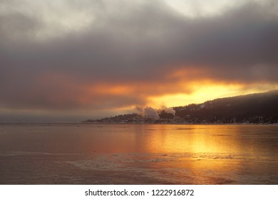 View of sunrise and coming up smoke from factory over Drammens fjord, Noway.