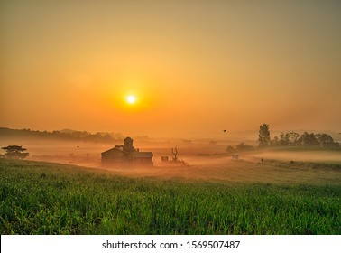 a view of the sunrise of a farmhouse