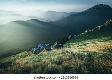 view at sunrise on top of italian alps mountains - weekend activities vacation and sport concept with adventure people - dark mood matte filter