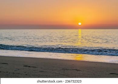 view of sunrise with sea in Torremolinos, Spain