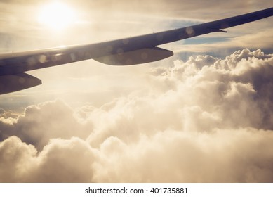 View of sunset from airplane, background for travel and journey concept, Toned Image
