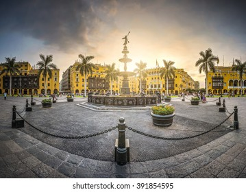 View at the sunset of the antique iron pool of the main square of Lima, Peru.