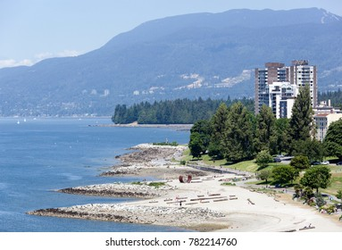 The view of Sunset Beach and park in Davie Village, the district of Vancouver downtown (British Columbia).