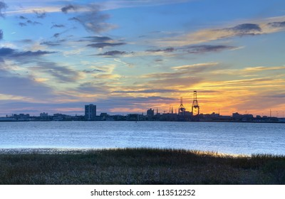 A View of the Sunset Behind the Port in the Harbor of Charleston, SC