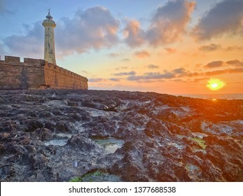 The view of sunset at the coast with a lighthouse of Plage de Rabat, the capital city of Morocco, in April.