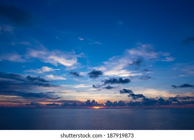 View of sunset into the ocean with twilight sky