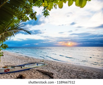 View of the sunset on a sandy beach in Moalboal, Cebu, Philippines. Copy space for text