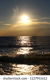 A view of a sunset over Lake Michigan that produces sunspots