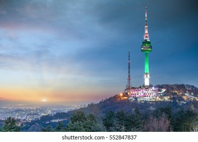 View of sunset in seoul city with seoul tower at namsan public park.